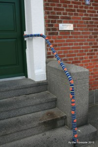 A pretty blue and orange railing.