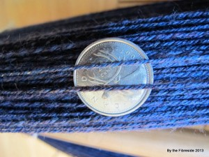 3-ply, two bluish one blackish, semi-worsted (worsted spin from carded prep).
