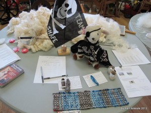 Yarrrr(n), we're all ready to go! Mascot, sample, yarns, and fleece ready to be spun! Oh, and my sabre...